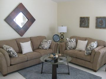 3rd bedroom set up as family room with large queen sofa bed if needed