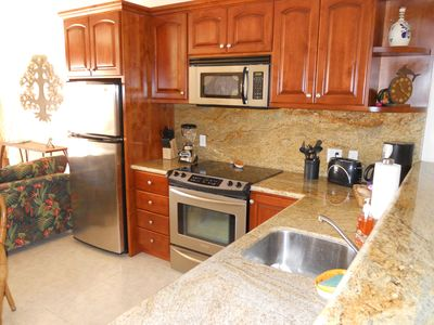 Fully equipped granite and stainless kitchen