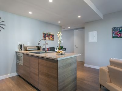 Get Into The Unit in Minutes From Airport, Downtown. Covered Access to SkyTrain