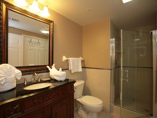Veiw of upscale master bath with granite counter and beautiful all marble shower - Daytona Beach condo vacation rental photo