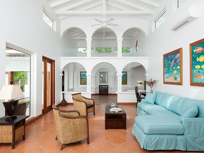 Open and airy living area with soaring 18-foot cathedral ceilings and arches