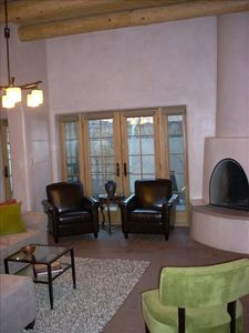 Beautiful living room with kiva fireplace