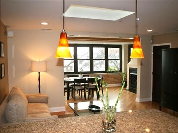 Chicago apartment rental - Family room, dining room with fireplace and lots of natural light