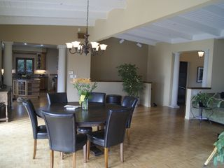 Tiburon house photo - Formal dining room area with views, pillars separating from the gourmet kitchen