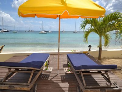 Bella Mare's private deck with beach lounge chairs