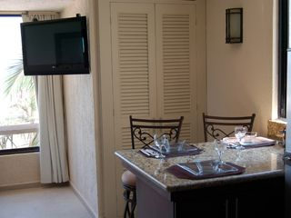 Cancun condo photo - Bistro counter, TV and closet