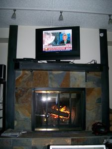 TV over the fire place. Free fire wood.