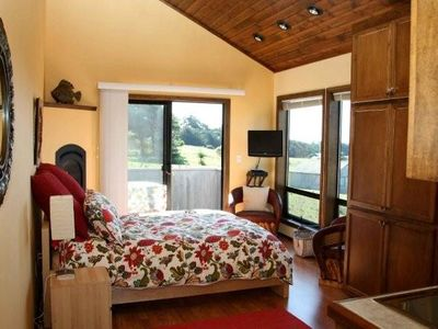Casita bedroom with private deck located above the garage