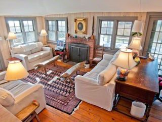 Chilmark cottage photo - Living Area Has Vaulted Ceiling With Walls Of Glass Windows & Doors, Fireplace
