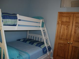 Bunk bed room full & twin with views of pine cove and Goose Bay. - Alexandria Bay cottage vacation rental photo