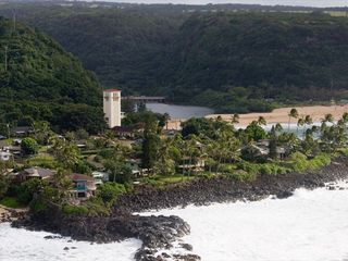 Waimea Bay house photo - Located on this rocky point
