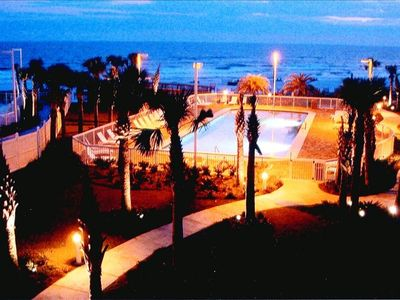 One Of Our Three Pools At Night With The Beach Behind It!