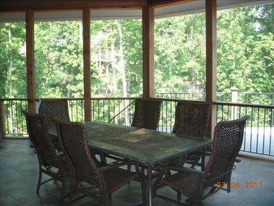 Outdoor dining from screen-in porch on main level and adjacent to kitchen.