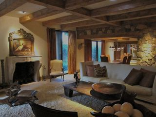 Indian Wells house photo - Great room/dining room with beams and rock wall detail