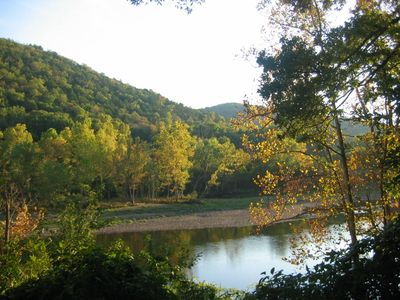 Branson condo rental - Autumn at Lake Taneycomo as seen from master bedroom and screened in porch.