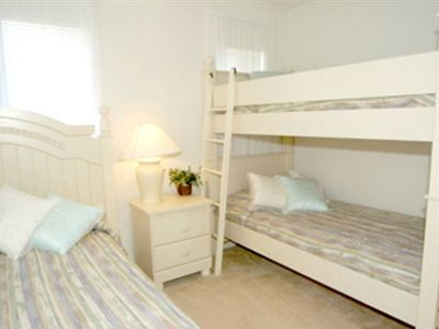 Bedroom 5 with set of bunk beds plus single bed.