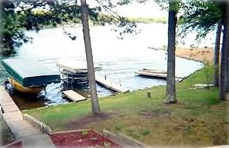 Our 2 PRIVATE Boat Docks & Boat Lift, with our SANDY SWIMMING BEACH to right!