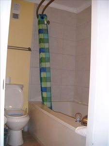 Jetted tub-new marble tile surround w/shower, new vanity,mirror,toilet,floors