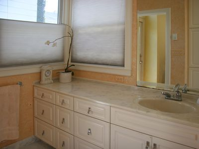 Bathroom, view of sink and windows