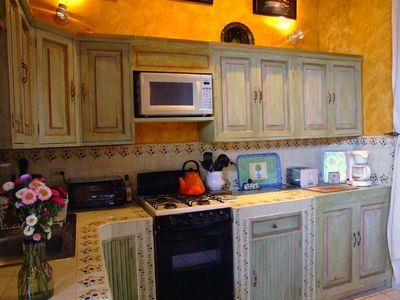 Fully-equipped kitchen with custom hand-painted cabinetry. Entertain with style.