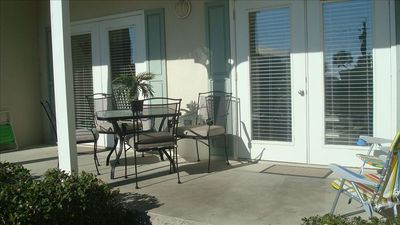 Large patio with two sets of french doors and new beach chairs you can use