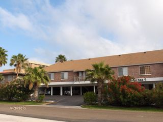South Padre Island condo photo - Exterior of our complex. Our unit is through the parking area to the left.