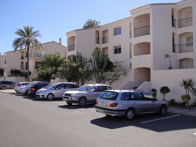 Front view of apartment with parking directly in front of the property.