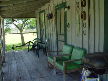 Front porch of cabin to sit and relax overlooking lake