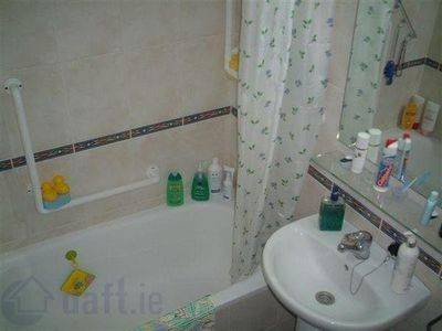 Bathroom c/w excellent power shower, basin, toilet & washing machine