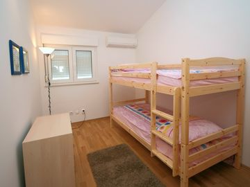 Modern & spacious room with it's own Clima /Air Conditioning.