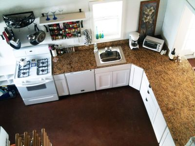 View of the kitchen from the master suite upstairs.