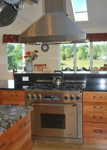 Kitchen with two Decor ovens, the one pictured includes a 6 burner gas range