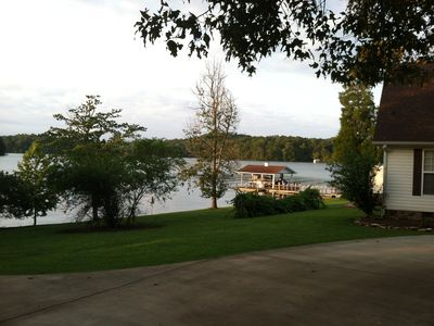 Looking to the left of our home from the driveway. Showing the boathouse & lake