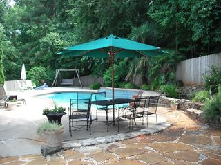 Atlanta house photo - Poolside with plenty of seating and lounge chairs, gas and charcoal grill.