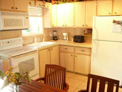 Fully equipped kitchen with seating for eight people.