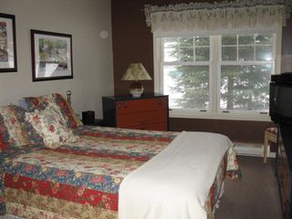 Mont Tremblant townhome photo - 3 bedroom townhouse ground floor bedroom with toilet and shower