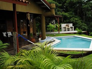 Mal Pais villa photo - An inviting entrance to the pool, patio, and deck with Argentinian style grill