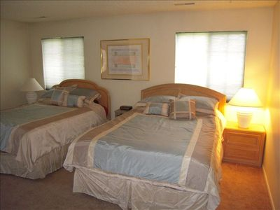 Main floor with 2 queen-beds and full bath. Porch access to hot tub and deck