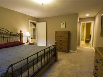 Master Bedroom with King bed and private bath. Also glass slider to back deck.