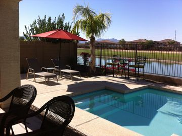 Laveen house rental - Enjoy the pool, lake, mountain and golf course view from your covered patio.