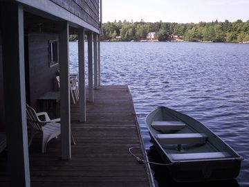 View of dock looking south with the row boat included in the rental.