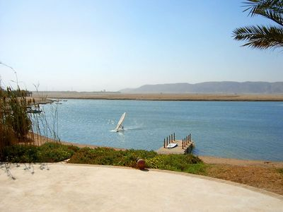 large villa with heated pool right on the lagoon beach with bathing jetty