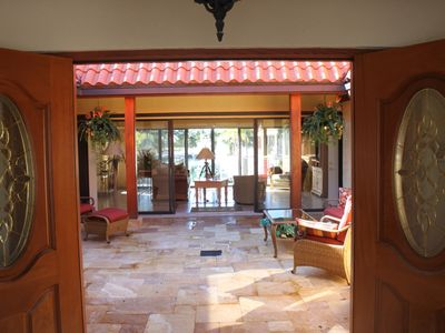 The front doors open onto a welcoming open air atrium leading you into the house