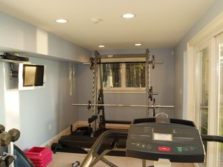 Bath house photo - Fitness room w/ water view
