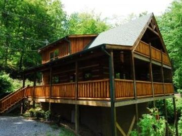 Gatlinburg cabin rental - Covered porches on 2 levels with porch swing on upper deck off the master suite.