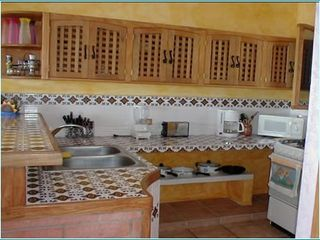 La Cruz de Huanacaxtle house photo - Fully Equipped Kitchen with Purified Water - 1/2 Bath off of Kitchen