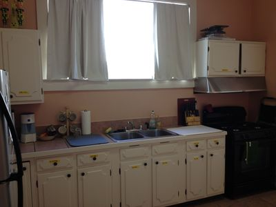 One side of the Kitchen off of Bedroom 1. Fully equipped plus coffee & beer!