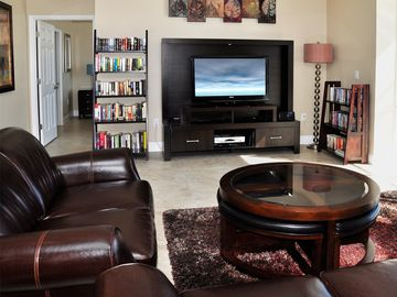 The Living Room with Entertainment Centre and Library