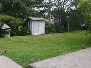 Point Judith house photo - Scenic backyard with shed filled with beach supplies!