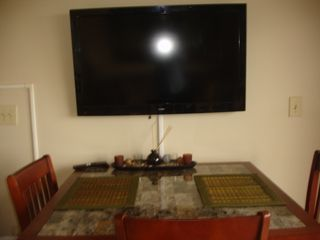 Carolina Beach condo photo - Dining Table and large mounted tv